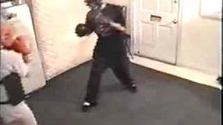 Woman Knocks Down Man Boxing