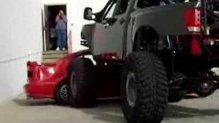 Nissan Titan Crushes Car