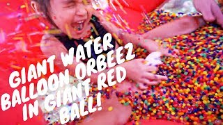 GIANT ORBEEZ WATER BALLOON IN GIANT RED BALL!! DOES IT EXPLODE??