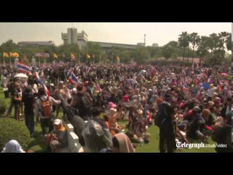 Thai protesters storm presidential palace as police stand aside