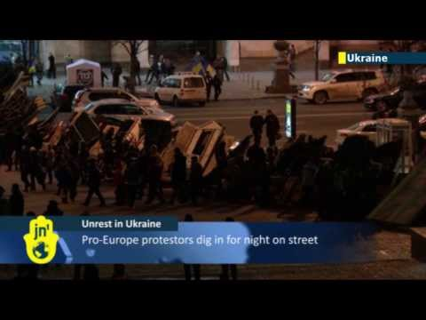 Protestors bed down: Pro-Europe protestors prepare for night on street