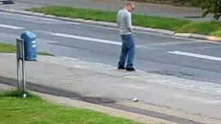 Moron Takes A Piss At A Bus Stop