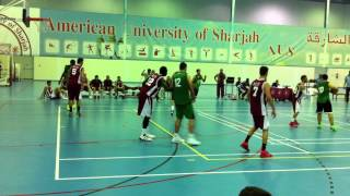 Tenacious defense by the Leopards. Yousef Mousa Shatat defends the basket. AUS v. UOS
