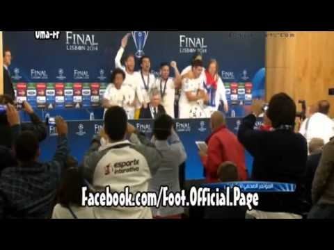 Real Madrid players celebrate with Ancelotti at the press conference