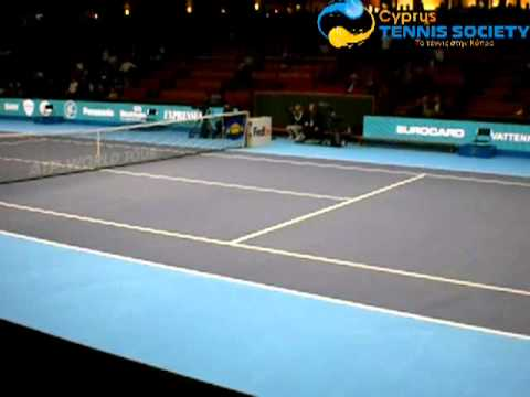 Marcos Baghdatis playing tennis with girl