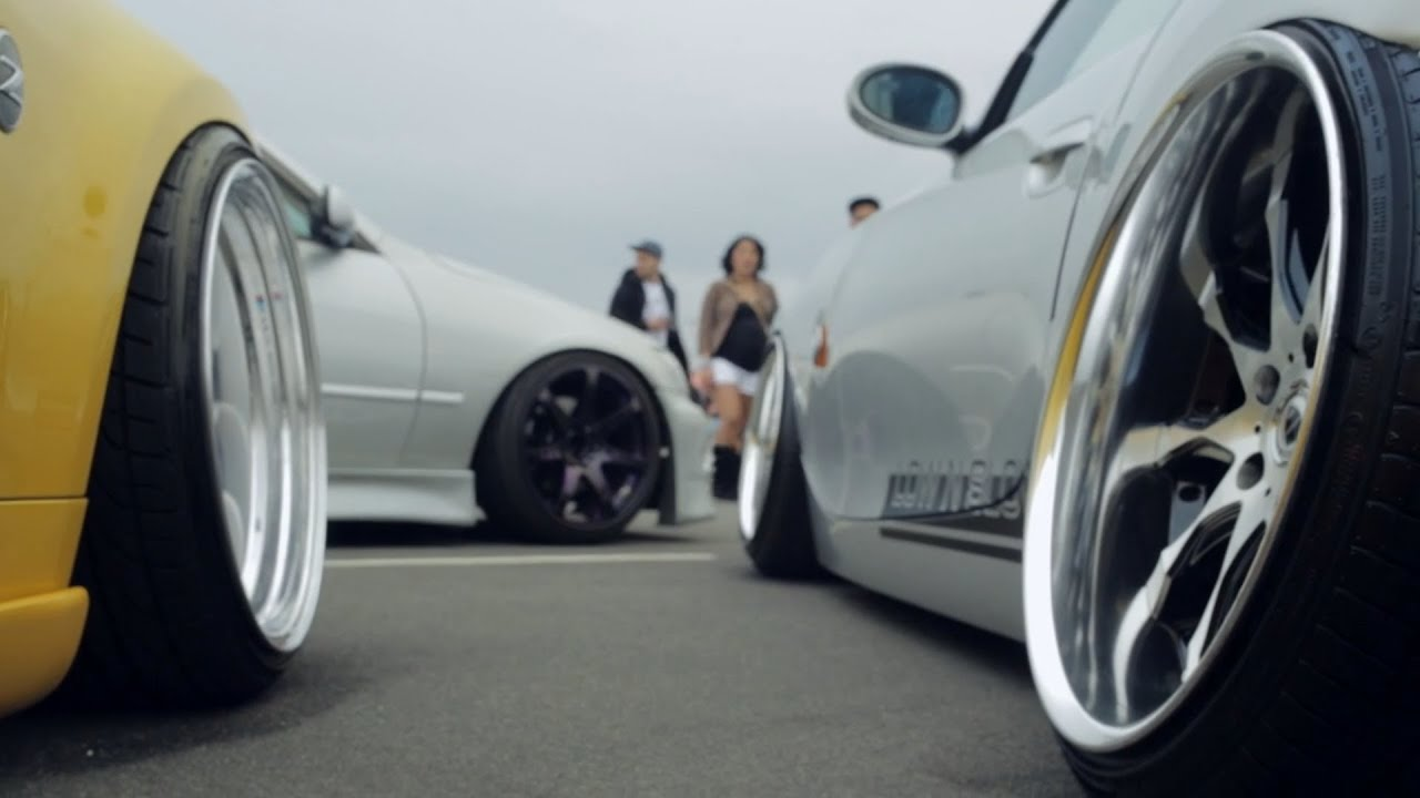speed and stance car meet in orange