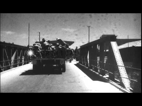 Arabs crossing bridge on Jordan river during timeframe of Arab-Israeli War HD Stock Footage