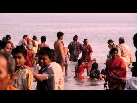 Devotees bathe at Ganga Sagar on the occasion of Makar Sankranti
