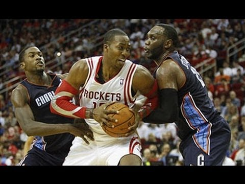 Dwight Howard Dominates in Debut