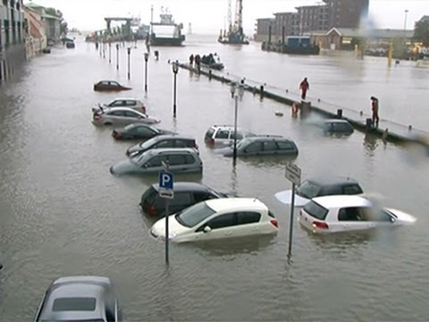Raw: Germany Storm Surge Submerges Cars