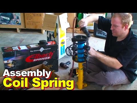 How to disassemble and reassemble a replacement strut and coil spring assembly