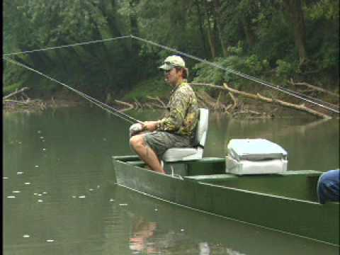 Flat Bottom Wooden Boats floating on the green river - YouTube