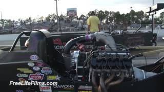 Dragster Pops A Wheelie Down The Track