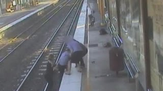 Dramatic footage: Trainee nurse saves man from train track in Australia view on youtube.com tube online.