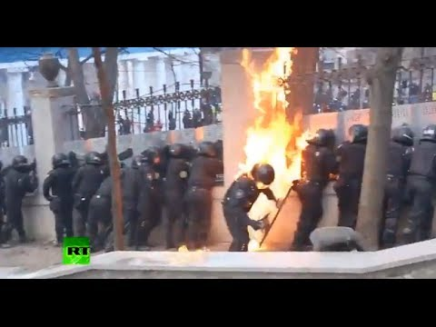 Cops on fire as Molotov cocktails flare, flash and bang over Kiev