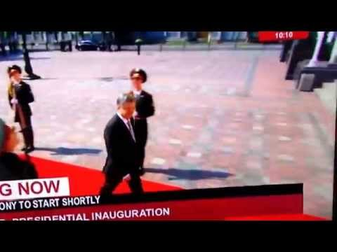 Soldier faint Petro Poroshenko walks in front of him. Ukraine sworn ceremony June 7 2014