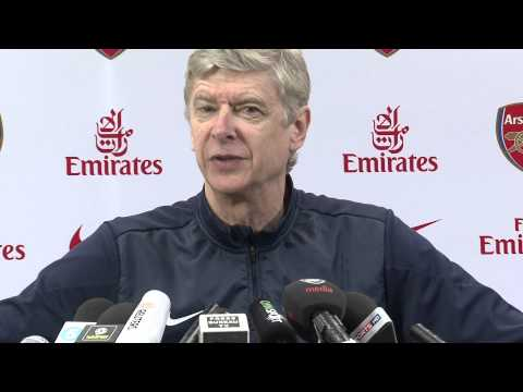 Wenger plays mind games with Mourinho