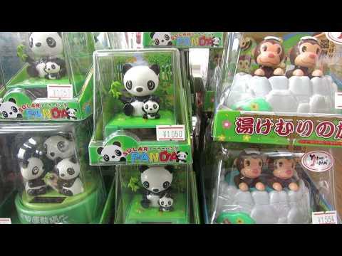 Nodding panda snow monkey souvenir toy tokyo Japan July 2013