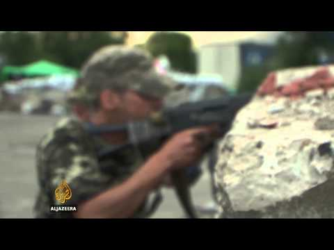 Ukraine's Luhansk residents flee amid cease-fire