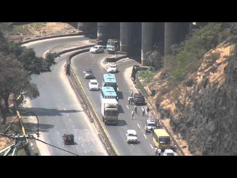 AERIAL VIEW OF VOLVO BUSES OVERTAKING VEHICLES AT MUMBAI PUNE EXPRESSWAY