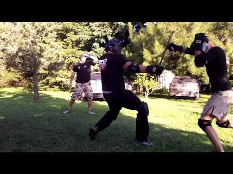 Profesorado de combate con palo