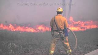 Firefighters Protecting Homes by Controlling Burns