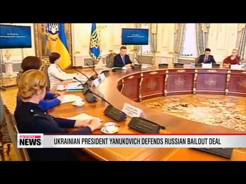 Ukrainian president defends Russian bailout deal