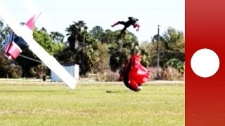 Plane hits landing skydiver during take-off, crashes into ground - pictures of collision