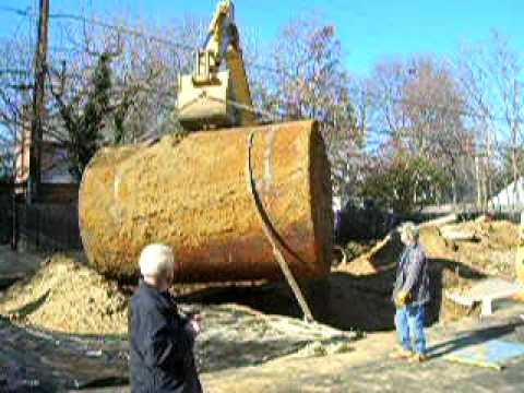 10,000 gallon fuel tank is lifted from a hole