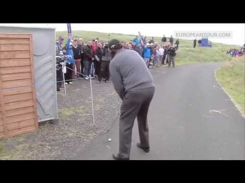 Phil Mickelson chips off a cart path to make birdie at the Scottish Open