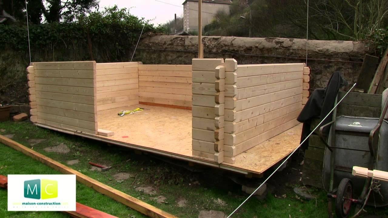 Montage chalet de jardin en bois madriers youtube - Pose abri de jardin ...