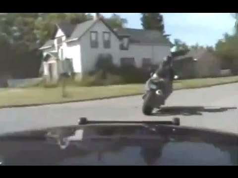 DashCam: See Ya!! Police chase fleeing motorcycle at high speeds, jump railroad tracks...