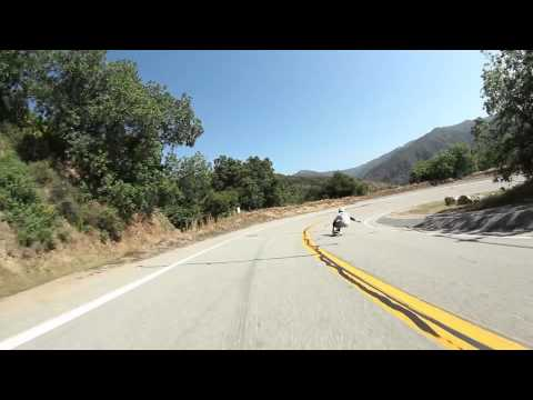 John Rogers longboarding down his local hill with Rad Train