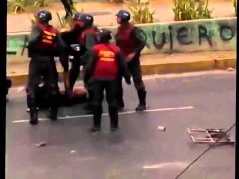 National Guard Beating a young student girl during protest in Valera, Venezuela.