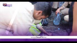 بالفيديو..جد مؤلم...عامل إنعاش يسقط مغمى عليه أثناء إطفائه حريق سوق المتلاشيات بأولاد تايمة | خارج البلاطو