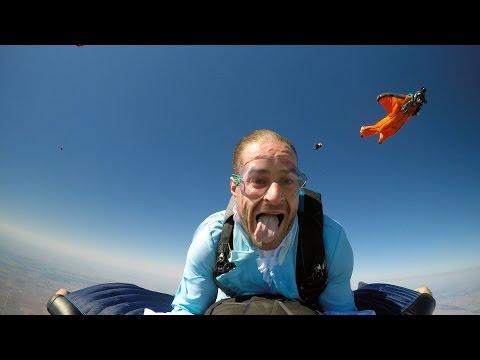 Mad Hatter piggy-backs Wingsuiter for 1,000th Skydive (120mph)