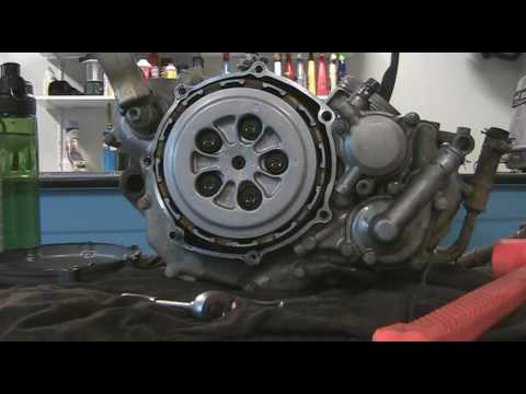 Part 23: How to disassemble a motocross bike. Removing clutch cover, water pump and kickstarter.