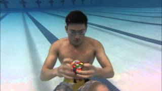 3 Rubik's Cubes Solved Underwater In 1 Minute