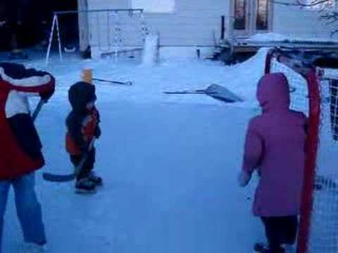 Kids on outdoor rink in backyard 1