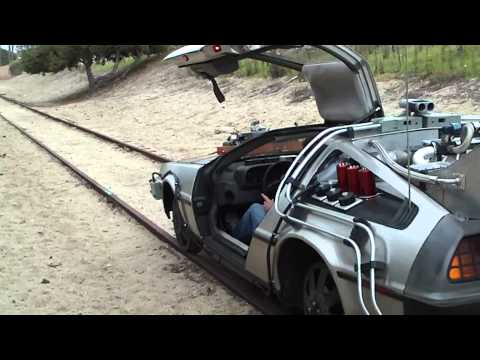 "Delorean on Train Tracks..., Preparation for the location tour portion of ""We're Going Back..."" The 25th Anniversary of Back to The Future Celebration of Back to the Future. This is the ..."