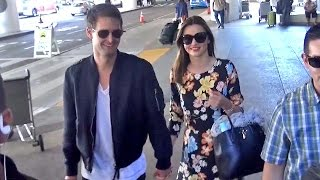 X17 EXCLUSIVE - Miranda Kerr And Evan Spiegel Hold Hands And Smile Big About Marriage At LAX
