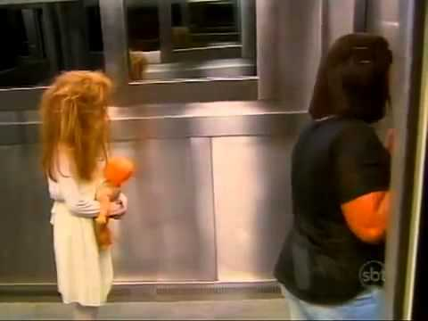 Girl scares people by standing in elevator (Prank)
