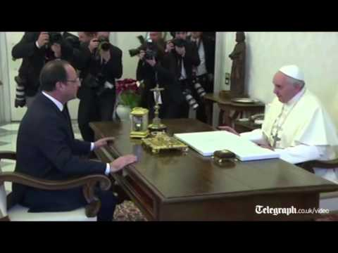François Hollande greeted by solemn-faced Pope at Vatican