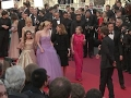 Kirsten Dunst wipes away tears on Cannes red carpet