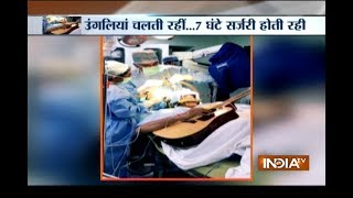 Unbelievable!- Bengaluru man plays guitar while doctors pe..