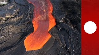 Molten lava streams down Hawaii's Kilauea volcano, helicopter footage