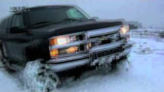 Lifted Monster Chevy Truck Crawling In The Snow