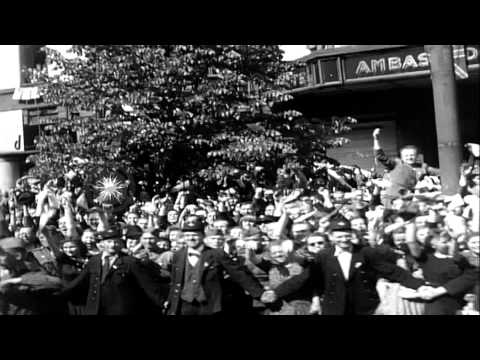 Crowds cheer former Czech President Eduard Benes as he rides along the streets in...HD Stock Footage