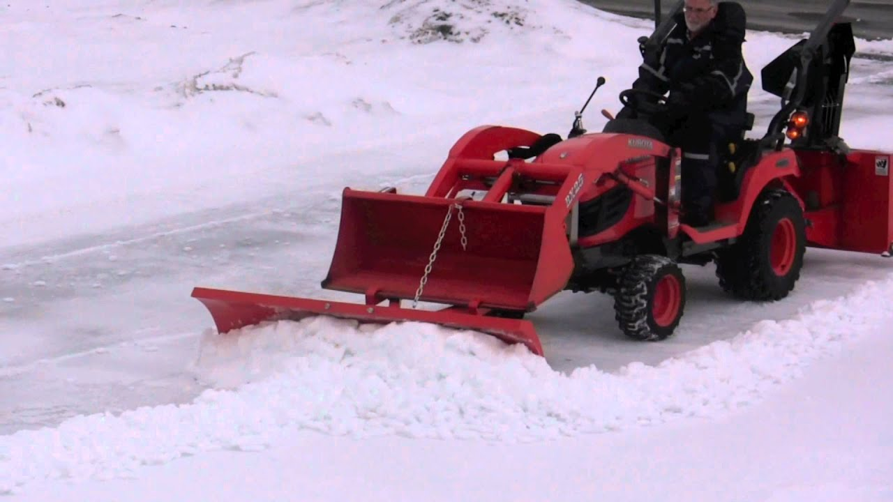 Snow blower plow and bucket on kubota bx clearing hard snow youtube