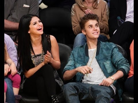 "Caught on kiss cam :x, Justin Bieber & Selena Gomez Caught On Kiss.That`s so cuteee :D Selena is shy :"">"